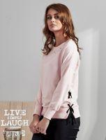 Różowa bluza z rozcięciami i perełkami                                  zdj.                                  2