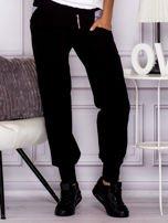 Spodnie dresowe z ozdobnym suwakiem czarne                                  zdj.                                  1