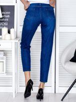 Spodnie jeansowe ciemnoniebieskie z perełkami                                  zdj.                                  2