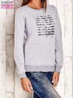 Ecru bluza z tekstowym nadrukiem