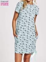 Turkusowa sukienka dresowa z nadrukiem ust i ozdobną wstążką