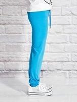 Turkusowe spodnie dresowe dla dziewczynki z kolorowym jednorożcem                                  zdj.                                  3