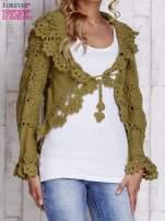 Zielony sweter o szerokim splocie z wiązaniem                                  zdj.                                  1